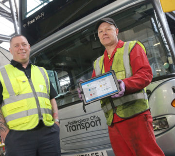 Liam O'Brien and Christopher Anderson of Nottingham City Transport Showing Tablet with Freeway Fleet Systems Software Displayed