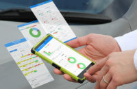 Freeway Fleet Systems' business analytics being used on a smartphone
