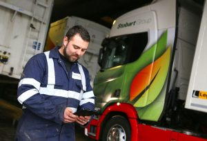 Stobart Energy Engineer Using Freeway Fleet Systems' Compliance Fleet Management Software on a Tablet
